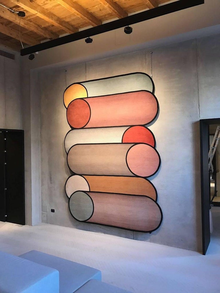 Rotazioni designed by Patricia Urquiola plays on the repetition of overlapping cylindrical forms that emphasize the circle as the matrix of the design. A scale of pastel colors and chromatic contrasts insinuate the gradient on the surface of the