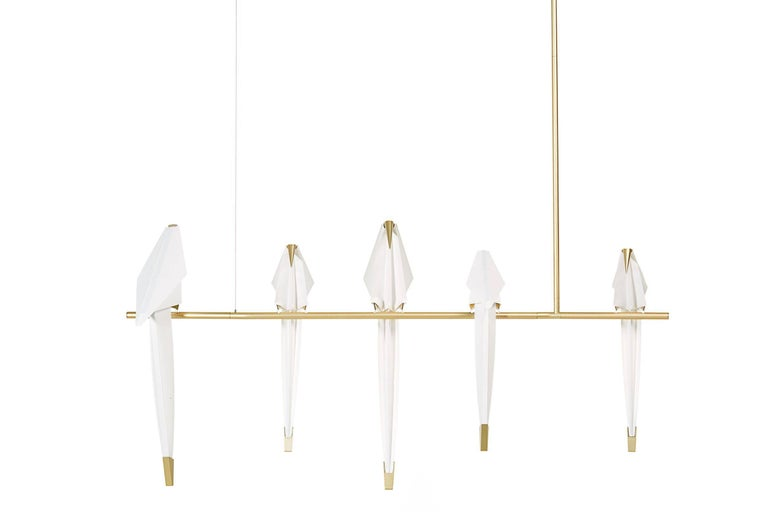 Perch light branch.   Moooi Perch Light Branch Chandelier with LED bulbs.  A bird is gracefully balanced on a tall metal perch, beautiful and proud, a swinging glimmer of warm light. Yet you are inside, after daylight has faded, under the spell of