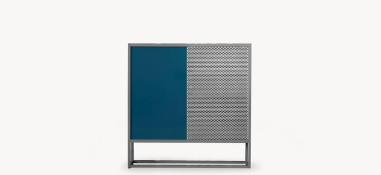 Moroso library bookcase by Jörg Schellmann in blue, green, orange or yellow steel.