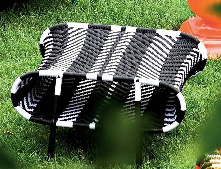 Seating made using woven threads normally used for fishing nets, the designs are all different and original, like their names. Handwoven, they are human in their perfections and flaws.  Painted steel base and colored polyethylene threads