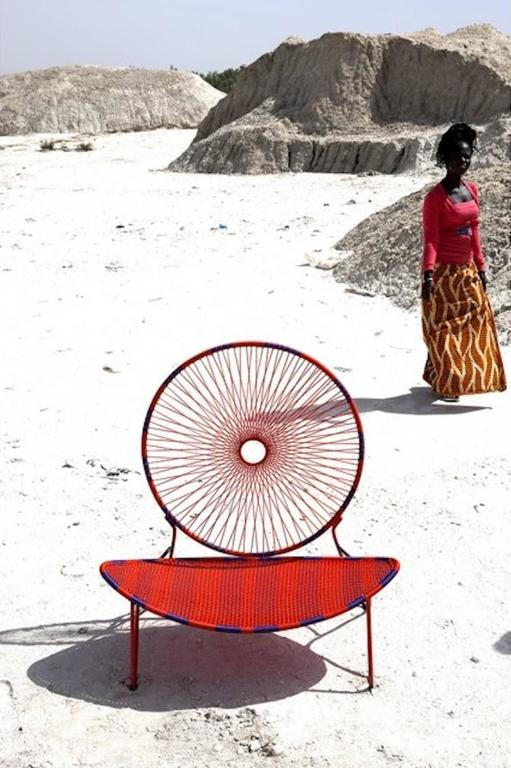 O)< chair is part of the M'Afrique collection, a range of furniture conceived by the various designers for Italian furniture manufacturer Moroso. Produced by African craft weavers using the yarn of fishing nets; the designs are all different and