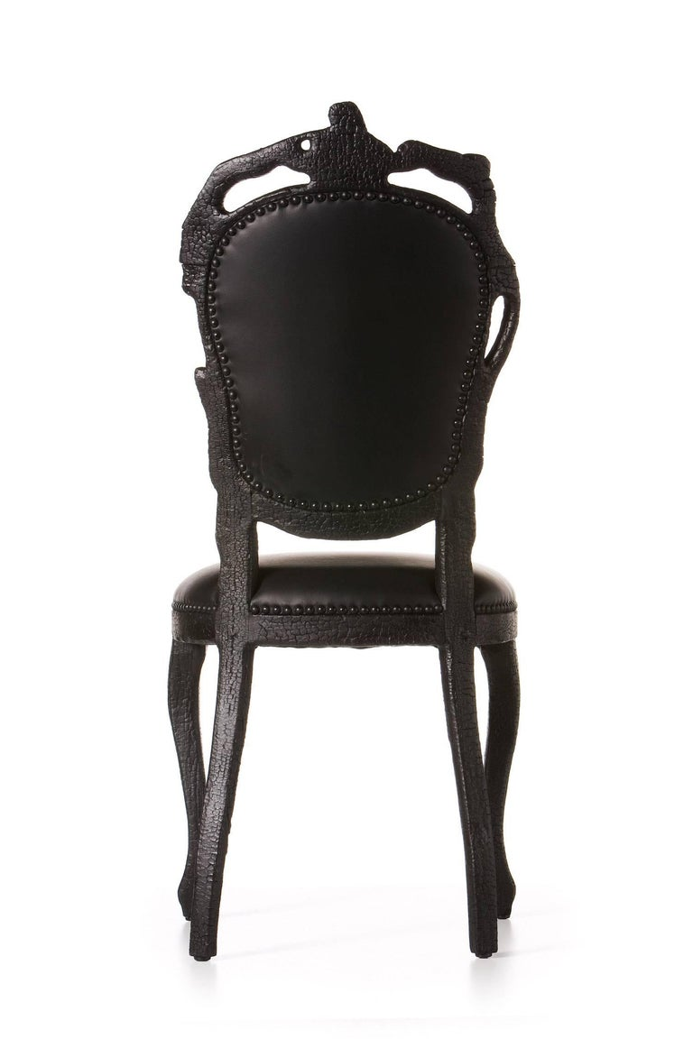 Smoke Wood Furniture ~ Moooi smoke dining chair in burnt wood and black epoxy by