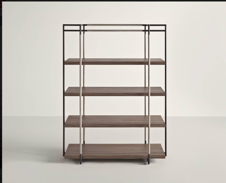 Bak bookcase in walnut, steel and leather in various colors by Ferruccio Laviani.  Bookcase with a lacquered steel frame upholstered with leather and walnut shelves.  Dimensions: H 165, W 128, D 48.