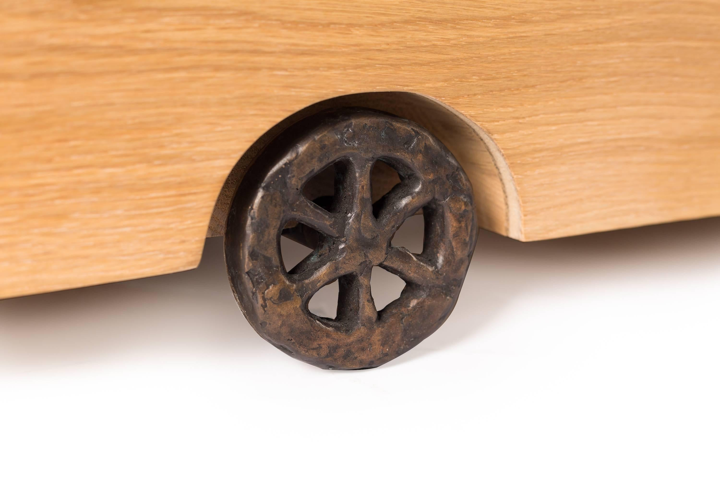Moooi Turbo Table Low By Maarten Baas In Natural Oiled Oak With Bronze  Wheels For Sale At 1stdibs