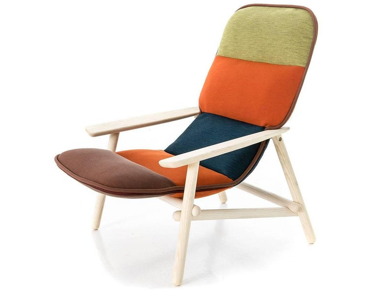 Moroso Quickship Lilo lounge chair by Patricia Urquiola in multi-color fabric and solid wood.  Inspirations and citations from Scandinavian design, from the modernist idea of the 1950s, from the work of the great masters of design and from Achille