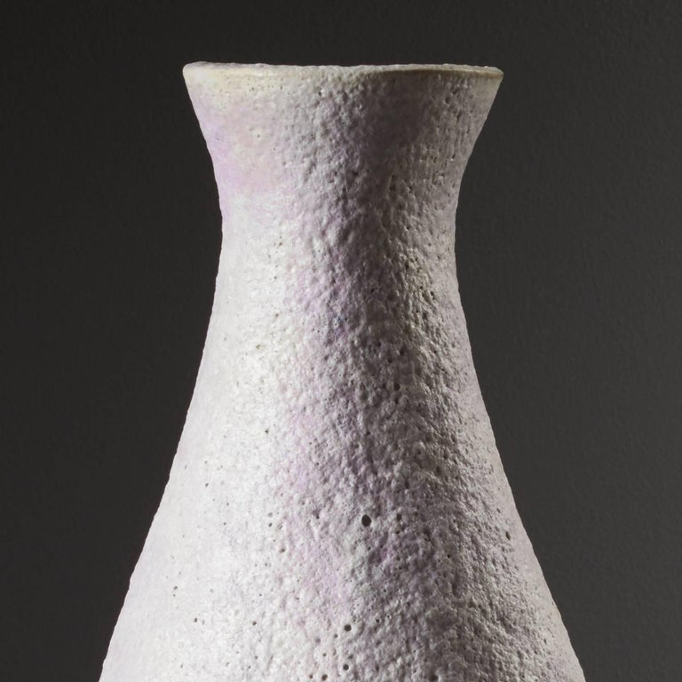 Pink Snow Vessel by ceramicist Iva Polachova, a textured piece of stoneware with a distinct volcanic glaze. A unique piece which has been coiled and crafted with simple scraping tools.