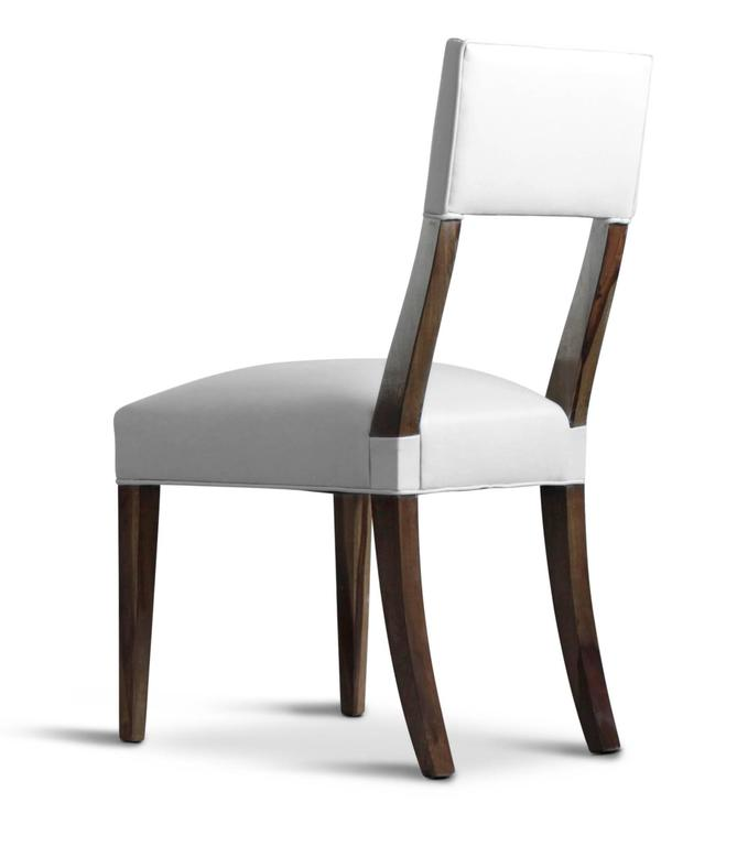 Costantini prides itself in using the hardest and most beautiful hardwoods in the construction of its line of seating. Shown in argentine rosewood, the Luca Chair's gently curved, high back exudes elegance and propriety. Usually in stock and ready