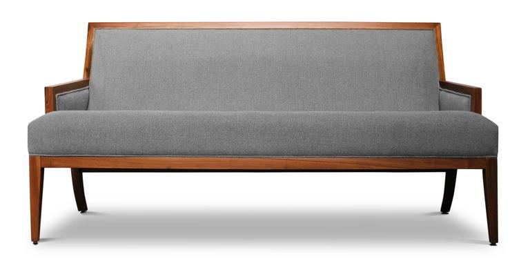 The Belgrano settee is inspired by mid-twentieth century modernist design and can be customized into any size.  Shown in Argentine Rosewood and fabric but available in any finish or upholstery material.  Handmade in Costantini's family-owned