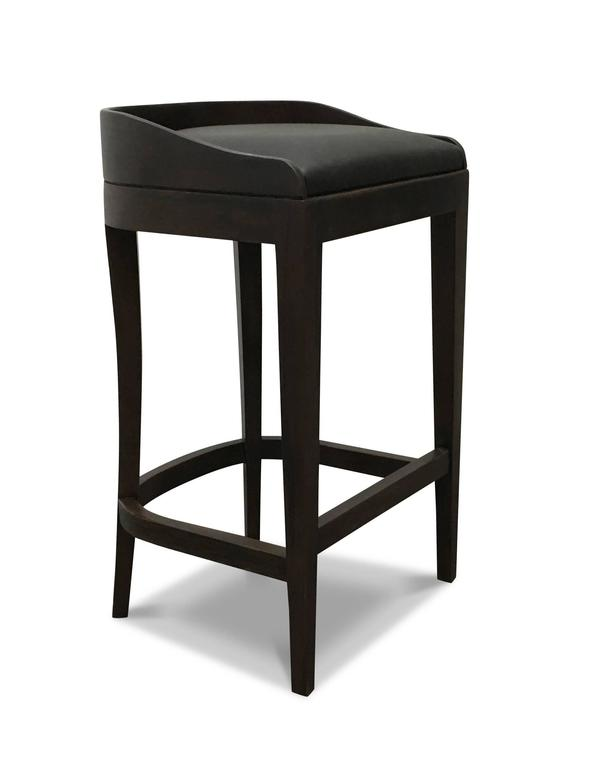 Costantini prides itself in using the hardest and most beautiful hardwoods in the construction of its line of seating. The Pia stool features a solid Argentine rosewood frame with a wrapped leather seat and low wood back. Available in several