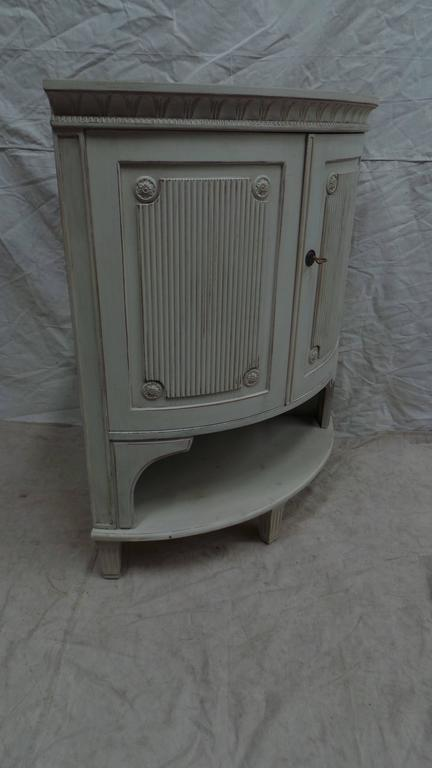 This is a unique Swedish Gustavian corner cabinet, these where used most often as a liqueur cabinet in a sitting room. its been restored and repainted with Milk Paints