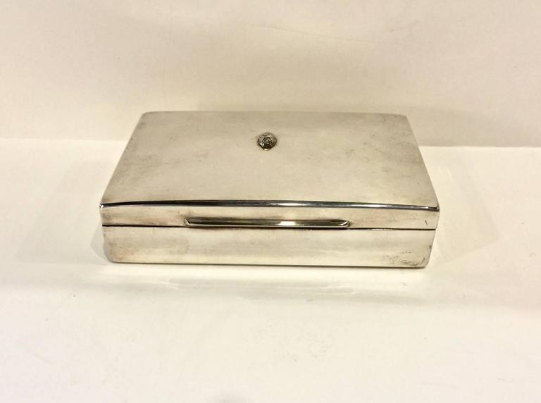 This a charming mid-20th century elegant silver plated box fitted as a bridge set that includes its original two decks of playing cards and four silver plated mechanical pencils each marked with a suit marker.