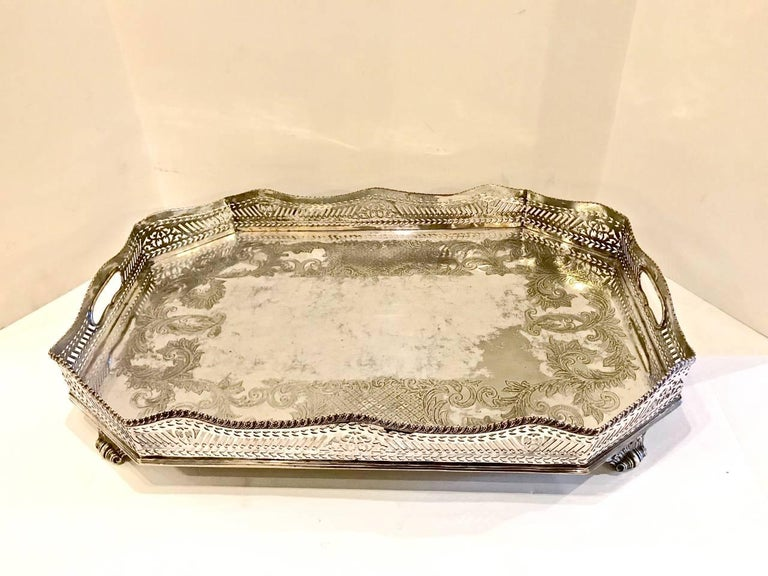 This is a 19th century (possibly early 20th century) large galleried Sheffield plate tray. The tray features a beautifully reticulated gallery and is further enhanced by acanthus scrolling feet. The tray is 8-sided and is further detailed with