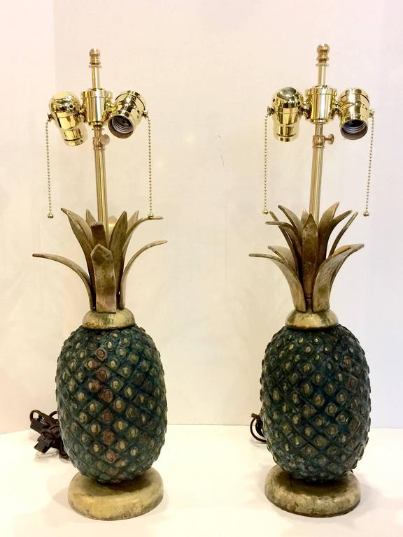 This is a superb pair of pineapple lamps by the famed Mexican modernist master, Pepe Mendoza. These heavy lamps were crafted in solid brass and are in excellent original condition with the exception of updating with new top quality electrical