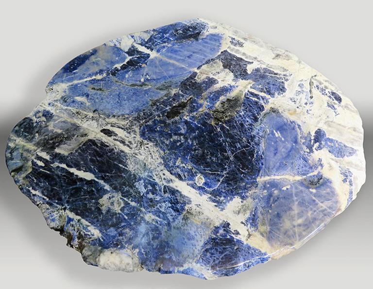 "This pair of center tables is made of sodalite slabs from Brazil. Sodalite o means ""sodium stone"", because its chemical composition presents great amounts of sodium. Sodalite is a very interesting mineral for collectors, since it is not easy to find"