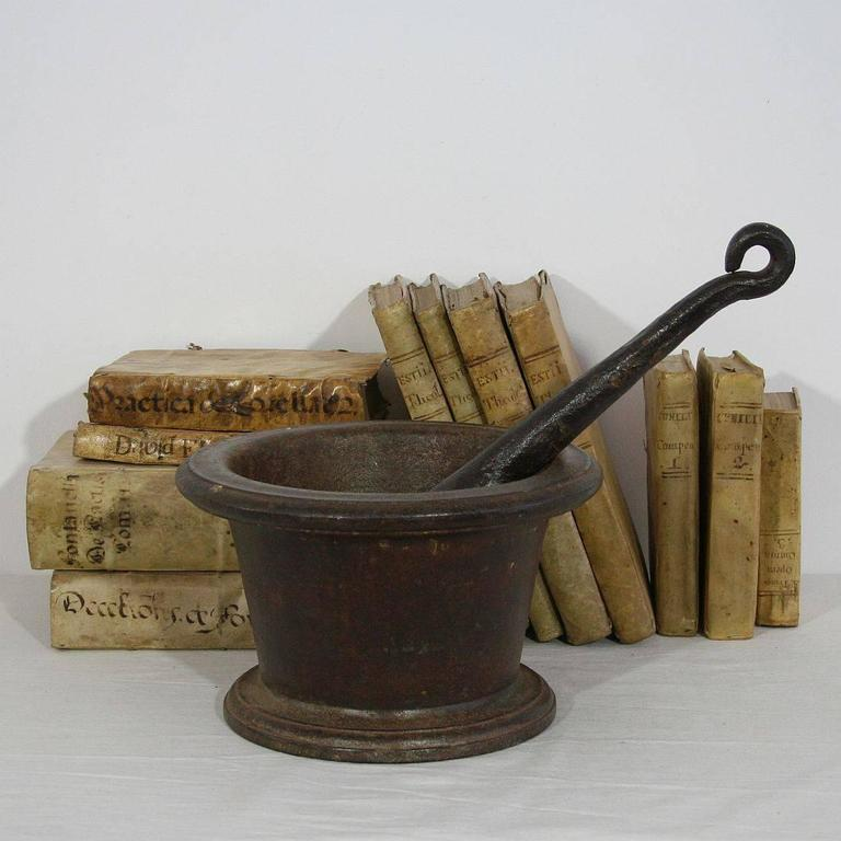 Beautiful cast iron mortar with its hand-forged iron pestle. Great patina