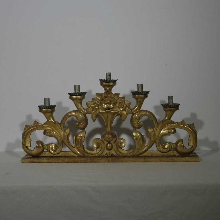 Unique Baroque giltwood candleholder with a bouquet of flowers, Italy, circa 1780. Weathered, repairs and losses.