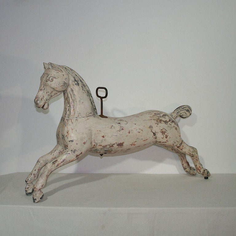 Beautiful carousel horse with traces of its original paint and stunning patina. France, circa 1880-1900. Weathered, small losses and antique repairs. More pictures are available on request.