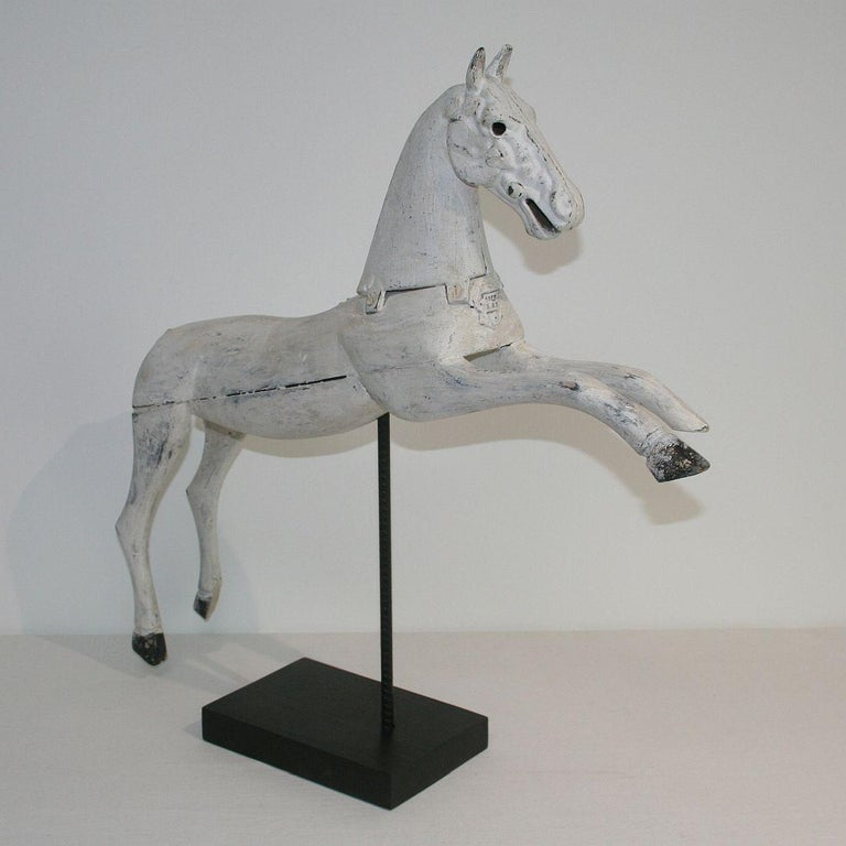 Beautiful white wooden horse with cast iron head, France, 19th century. Weathered, small losses. Measurement with the base.