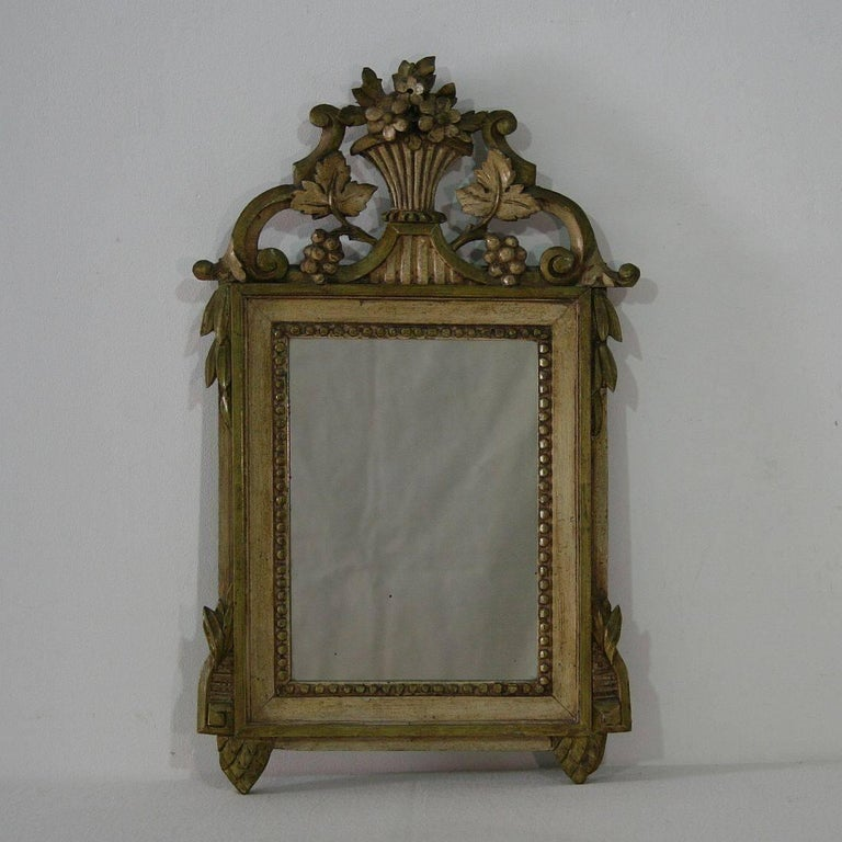 Very nice antique Louis XVI style mirror, France, 19th century. Weathered.