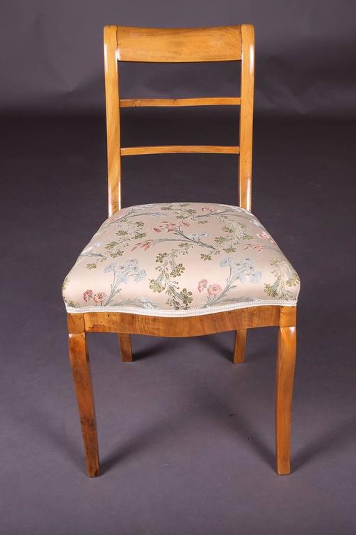 Solid birchwood. Chairs with curved legs. The chairs have been restored and upholstered not so long ago.  (C-128).