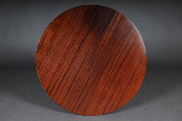 Solid wood, mahogany veneer. Slightly round round cover plate on four columns. Frame covered with pearl edge. X-shaped, profiled base. Extremely high-quality, gilded chased bronze applications. The entire corpus flanked by 4 columns.  (A-133)