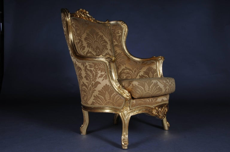 Solid beechwood, carved and gold frame. Semi-circular ascending backrest framing with Rocaillon crowning. Passive, carved frame. Slightly bent frame on curly legs. The seat and backrest are treated with a Classic, Classic upholstery, removable seat.