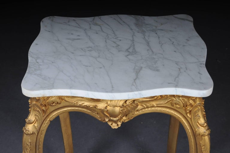Body completely set in gold. Carved frame ends with long curved legs. White mottled marble top.   (G-72).