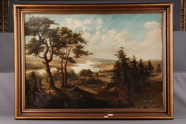 Oil on canvas, view from a mountain range with pines and fir trees on a flat river or lake landscape with farmsteads.