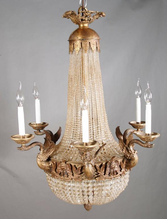 Splendid chandelier or candelabra in French Empire style Bronze patinated. There from, a with six swans designed light arms.  (F-Ks-2).