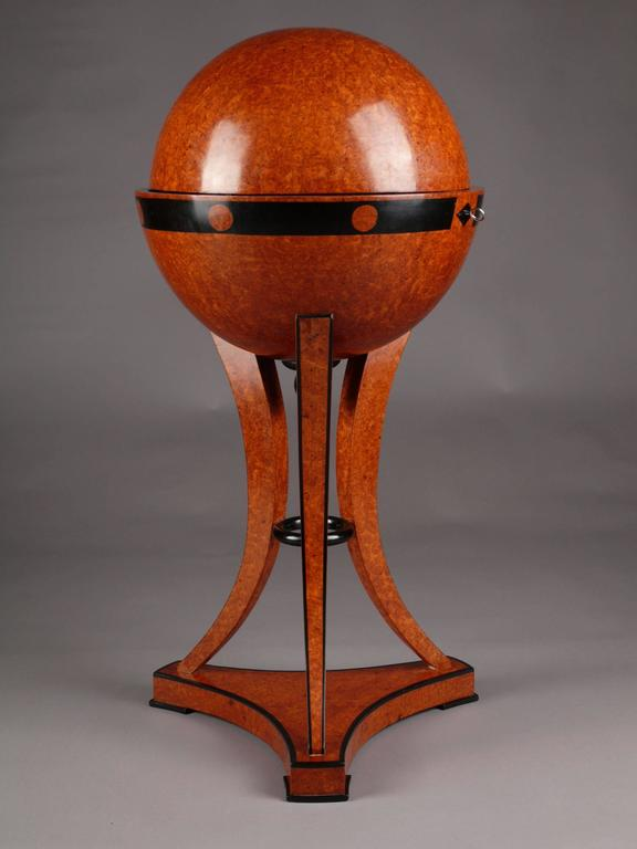 Highly significant globe sewing table in Vienna Biedermeier style. Bird's eye maple root veneer on solid beech, partially ebonized.  (G-Sam-44).