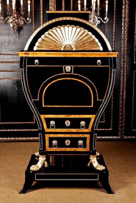 Ebonize, partially bird's-eye maple root veneer on solid Pinewood. Moulded Lions Masks with grisp rings. This so called lyre secretaire is the crowning of all European furniture Art of the Biedermeier period. Paw-feet and batons from solid