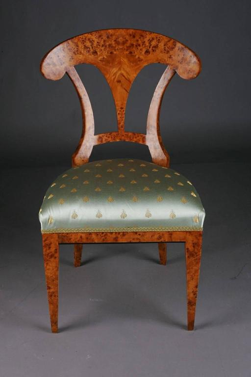 Solid beechwood with maple root veneer. Seat classical upholstered.   (C-Sam-34).