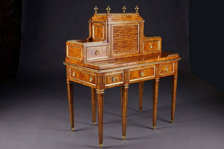 Writing desk or conversions table after David Roentgen (1780 -1795) bird's-eye maple veneer on solid pinewood. On the front side one real and two false drawers, on the side a secret drawer over conical pointed, with brass beaded legs. The drawer