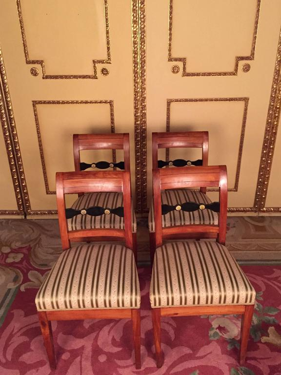 Beautiful set of Biedermeier chairs, circa 1830. solid cheerywood. Slightly arched backrest with straight top and middle bridge. Newly upholstered seat and covered with a high quality fabric. These chairs have been completely restored by an