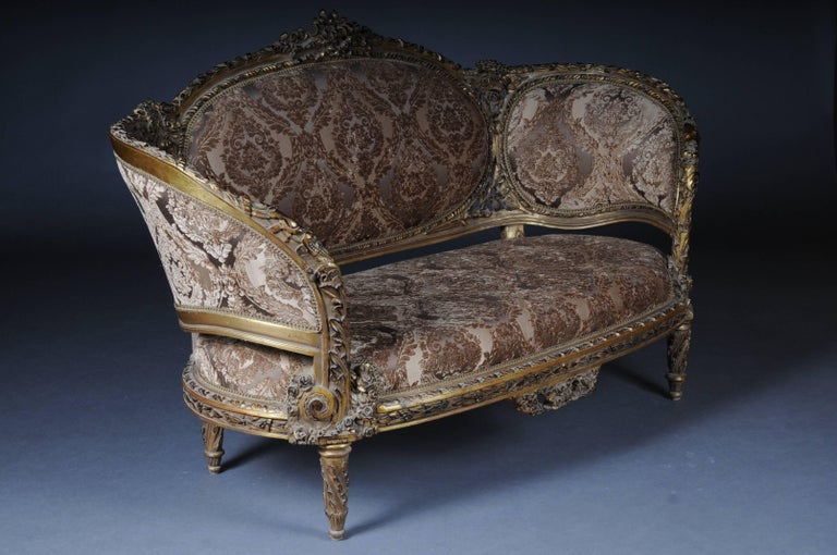 Solid beechwood, carved and painted. Semicircular rising backrest framing with openwork rocaille crowning. Appropriately curved frame with rich relief carved foliage. Slightly curved frame on curly legs. Seat and backrest are finished with a