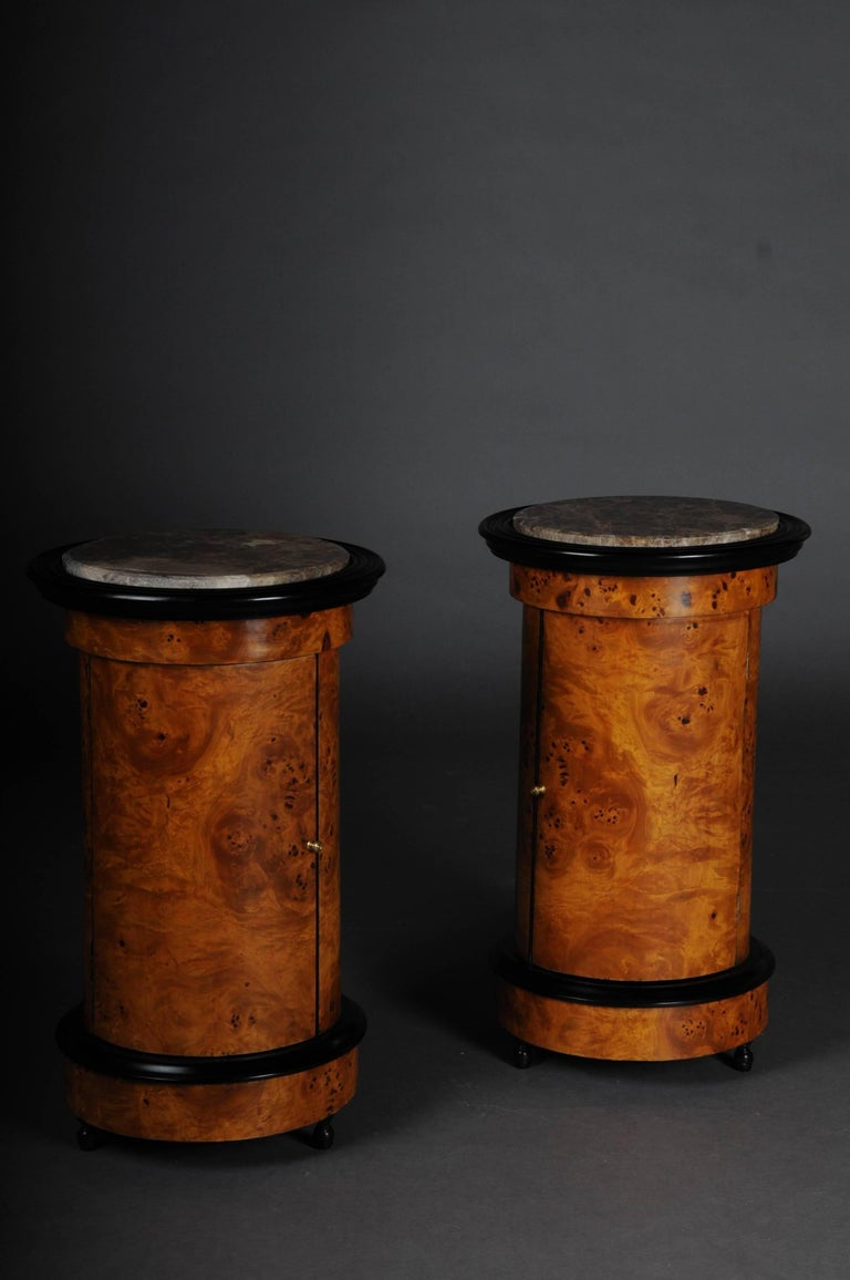 Maple root on solid softwood, partially ebonized. One door, left-opening cupboard in cylindrical form. Carcass on corresponding frame. Slightly protruding cover plate made of mottled marble. Partially ebonized. Inside shelf division. Such a piece of