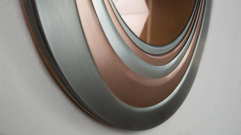 Mirrored are reflective objects constructed out of different types of metal layered together to create an organic feel.