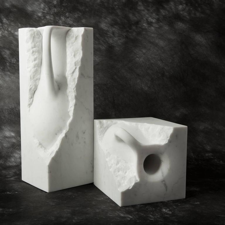 Svelata is a series of hand-carved vases made from a single block of Carrara marble.