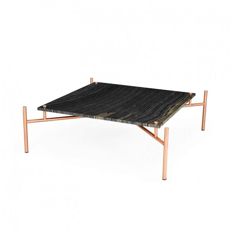 Marble coffee table with copper legs.