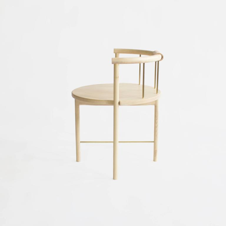 Solid maple construction / zero voc oil finished / brushed brass rungs / leather wrapped back support  Dimensions: 27 H (18in seat height) 23 W x 21 D.