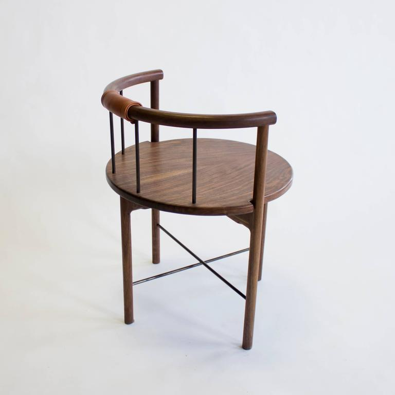 Solid walnut construction / zero voc oil finished / bronze rungs / leather wrapped back support   Dimensions: 27 H (18in seat height) 23 W x 21 D.