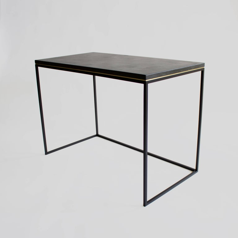 Blackened steel base / honed concrete top / choice of integral concrete color / inset brass or brushed steel detail.