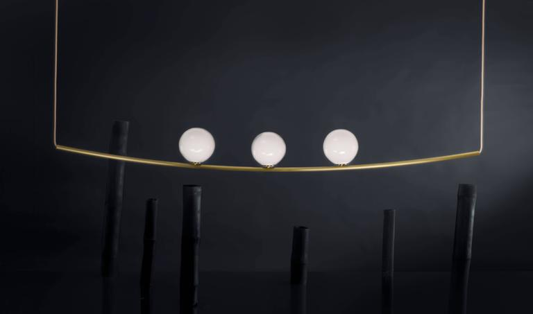 Perle 3 is a luxurious high-end lighting fixture that has been coated with warmth and elegance. Inspired by the romantic world of jewelry, the Perle collection is handcrafted with a delicate metallic structure and three 6'' handblown glass ball as