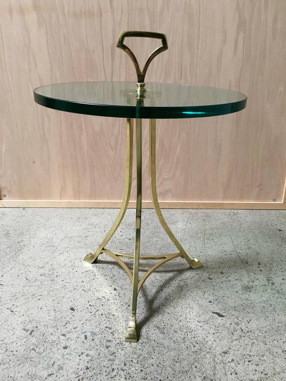 Mid-Century brass and glass end table.
