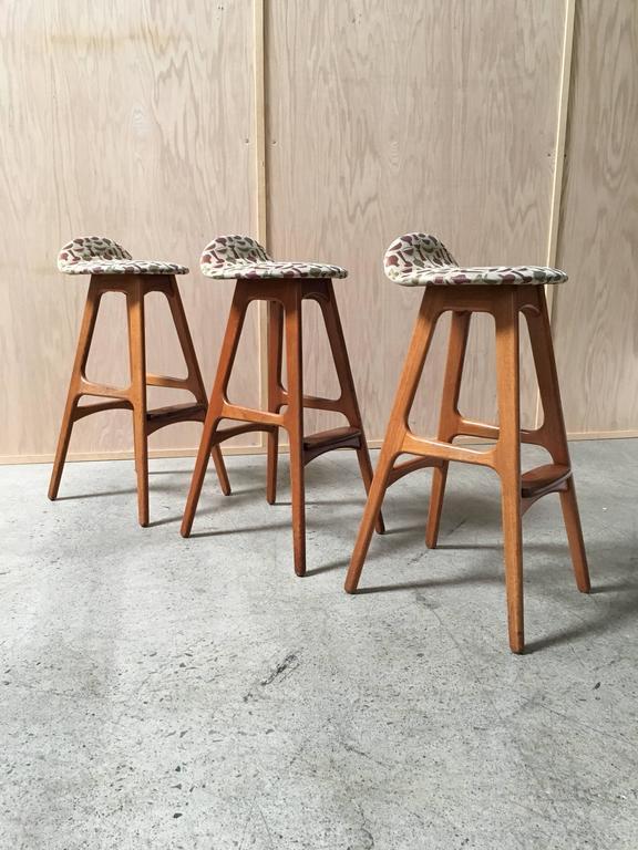 three teak bar stools by erik buch fabric by george nelson design