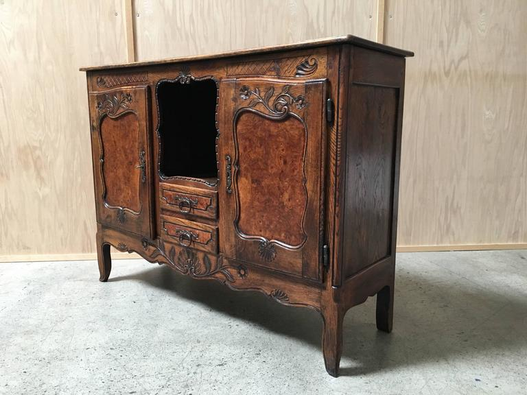 19th century antique rustic buffet with burl wood panels and forged iron hardware.