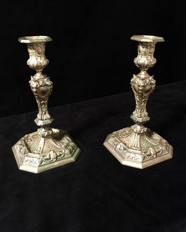 19th century antique Rococo style brass candle sticks with nice patina.