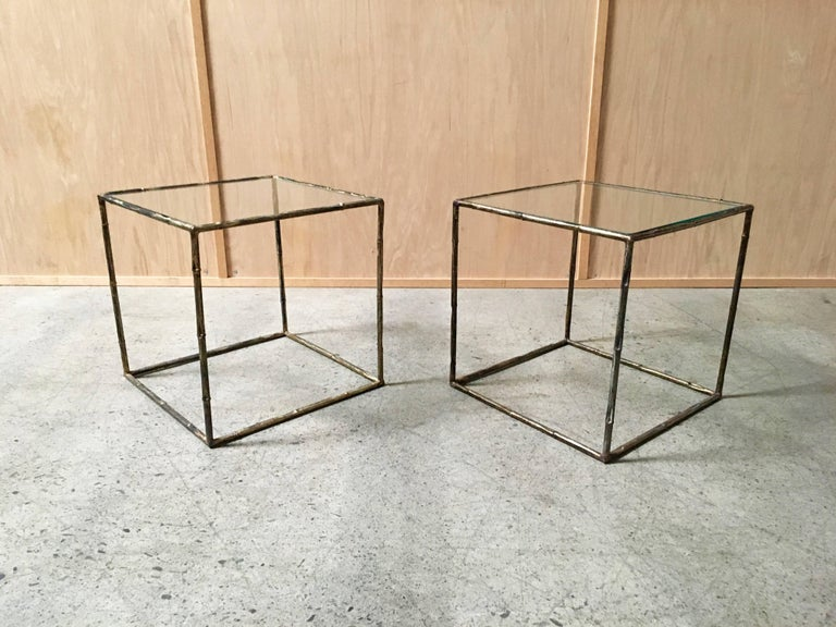 Pair of geometric cube faux bamboo end tables metal with glass tops.