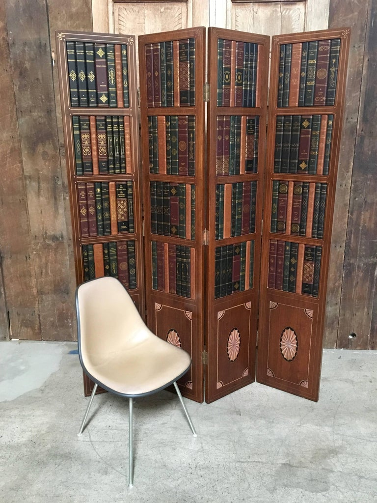 4 panel screen with faux books on the upper panel and inlaid marquetry on the lower panels with some hand painted details