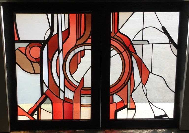 Studio crafted stained glass abstraction. These pieces have been custom framed for display.  Two panels measures: 30.5